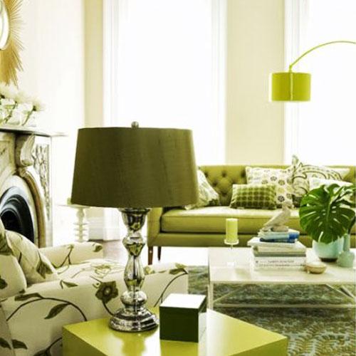 Muebles verdes en un salón con cierto estilo vintage